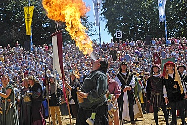 Fire-eater at move of the comedians in mediaeval medieval costume in arena, knight festival Kaltenberger Ritterspiele, Kaltenberg, Upper Bavaria, Germany