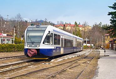 Electric Tatra train at the Tatranska Lomnica train station and the Grand Hotel Praha (back), Slovakia