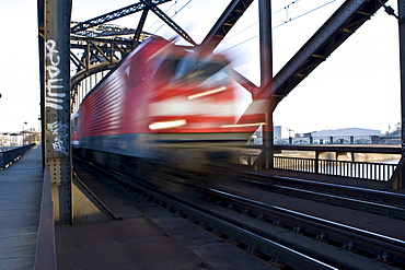 German Rail train driving over a bridge fast, Hesse, Germany, Europe
