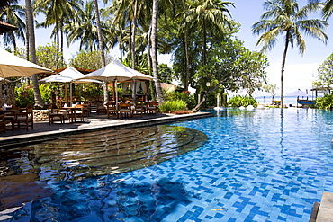 Swimming pool complex and terrace restaurant of the Sheraton Hotel near Senggigi, Lombok Island, Lesser Sunda Islands, Indonesia