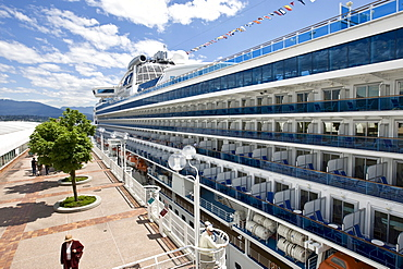 "The passenger cruise liner ""Diamond Princess"" docked in front of the Pan Pacific Hotel in Vancouver, British Columbia, Canada, North America"