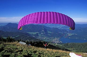 Paraglider Zwolferhorn mountain Wolfgangsee St. Gilgen Salzkammergut Austria