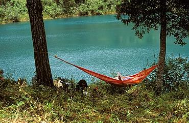 Man reading in hammock , Lagunas de Montebello - Chiapas Mexico