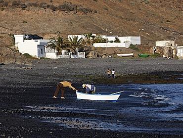 Two fishermen disembarking , Lajita , Fuerteventura , Canary Islands