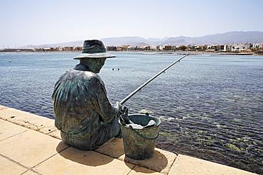 Fisherman sculpture in Arinaga, Gran Canaria, Spain
