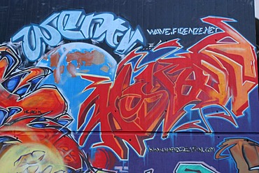 Colorful graffiti in an industrial quarter of Zurich near the train viaduct of Wipkingen.