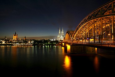 Cathedral, Hohenzollern bridge and St. Martin church seen from the right Rhine river bank, Cologne, NRW, Germany