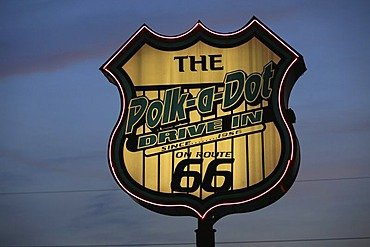 Polk-a-Dot Drive-In Sign and neon illumination at dusk on historic Route 66, Illinois, USA