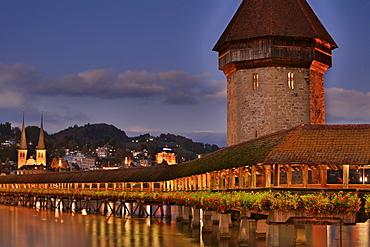 Historic Kapell Bridge, Water Tower and Hofkirche Church (in background), Lucerne, Switzerland