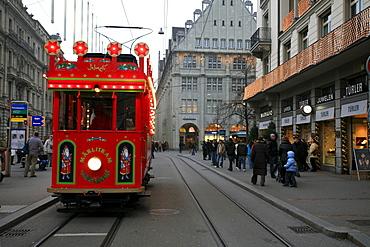 Historic fairytale tram on a round course in downtown Zurich from Bellevue - Limmatquai - Bahnhofstrasse, Zurich, Switzerland