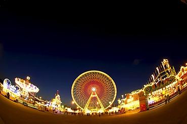 Fun fair with chairoplane and Ferris wheel