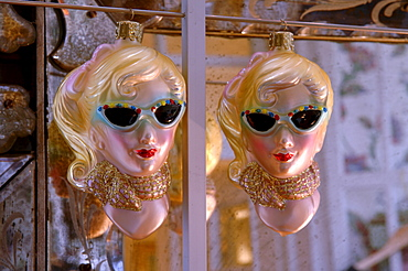 Retro ornaments from the 1950s featuring two blonde women wearing sunglasses and scarves