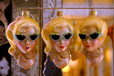 Retro ornaments from the 1950s, three blonde woman wearing sunglasses and scarf and red purse