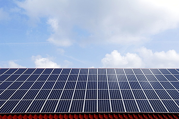 Photovoltaic cells, solar panels installed on a roof, Oberruesselbach, Middle Franconia, Bavaria, Germany, Europe