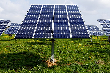 Photovoltaic cells, solar panels mounted in a field, Oberruesselbach, Middle Franconia, Bavaria, Germany, Europe