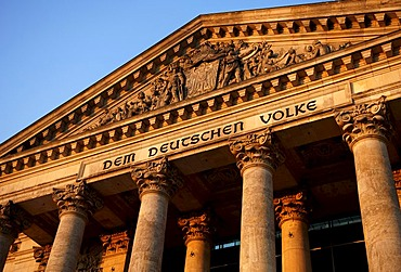 Writing, Dem deutschen Volke, The German People, detail on the Reichstags or parliament building in evening light, Berlin, Germany, Europe