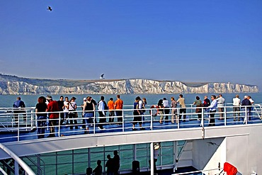 Passengers on a ferry viewing the white cliffs of Dover, Dover, England, Great Britain, Europe