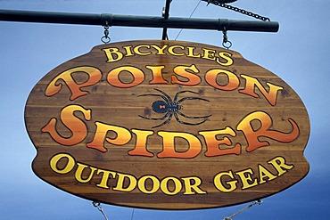 Sign, Mountain bike shop, Poison Spider Trail Moab, Slickrock, Utah, USA