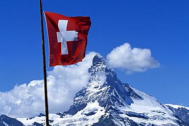 Swiss flag in front of the Matterhorn, Zermatt, Valais, Switzerland, Europe