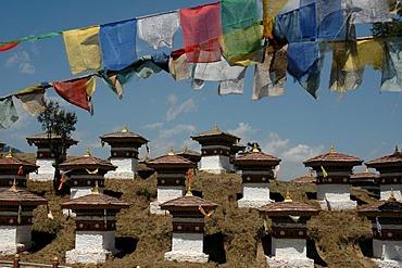 Bhutan, Kingdom, Himalaya, chorts and prayer flags on a slope