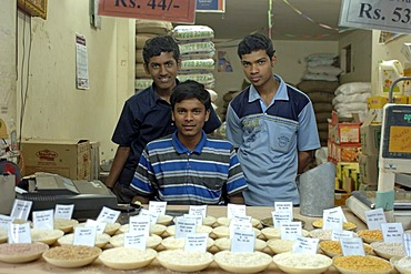 Salesmen in a grocery, Bangalore, India