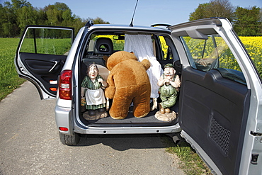Props loaded into the boot, back of a car