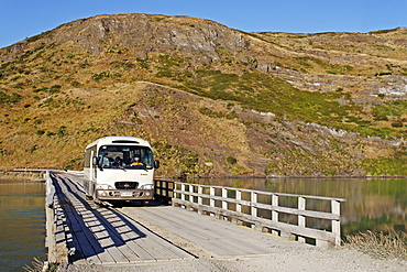 Bus crossing a wooden bridge, Torres del Paine National Park, Patagonia, Chile, South America