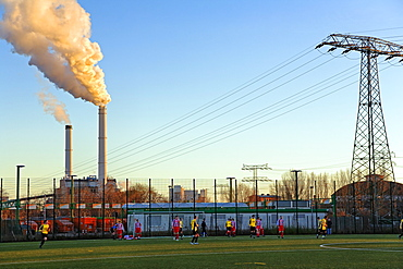 Football field in front of Klingenberg Power Station, Berlin-Lichtenberg, Berlin, Germany, Europe