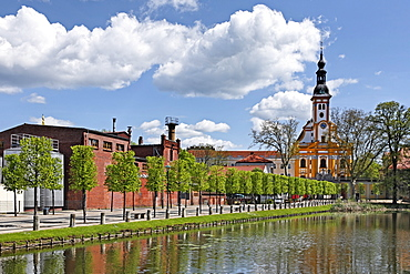 Cloister brewery and St. Marien Abbey Church on the abbey¥s pond, Neuzelle, Brandenburg, Germany, Europe