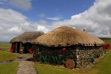 Museum of Island Life showing old turf houses on the Trooternish Peninsula, Isle of Skye, Scotland, United Kingdom, Europe