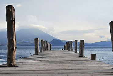 Wooden jetty, volcano, Lake Atitlan, Guatemala, Central America