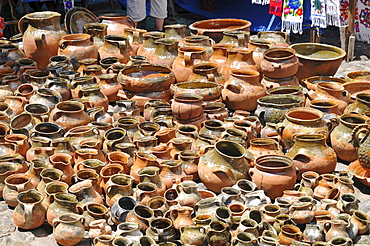 Clay pots sold at a street market in Chichicastenango, Guatemala, Central America