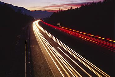 Traffic at dusk, Inn Valley autobahn, North Tirol, Austria, Europe