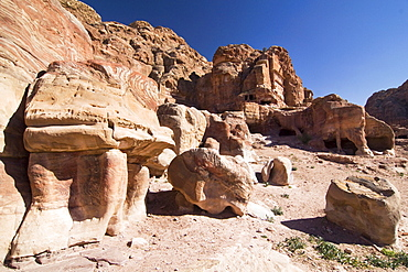 Tombs cut into cliffs, rock face in Petra, Jordan, Middle East