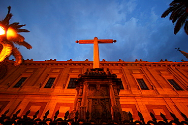 Cross in front of the Archivo de Indias (Archive of the New World) in Sevilla at night, Sevilla, Andalusia, Spain, Europe
