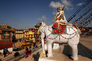 Decorated statue of elephant and rider guards the entrance to Bodnath Stupa in Kathmandu, Nepal, Asia