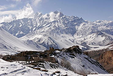 Dramatic scenery: the remote mountain village of Jharkot set against a backdrop of snow-covered mountains along the popular Jomsom Trail, Jharkot, Nepal, Asia