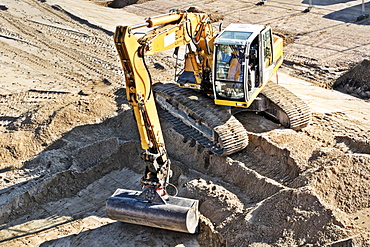 Excavator at a construction site, Hamburg, Germany, Europe