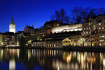 Limmat River with St Peter's Church in evening light, Zurich, Switzerland