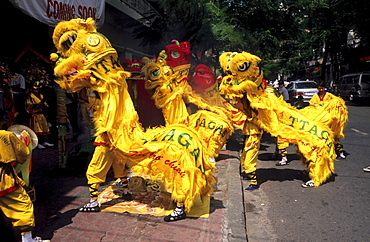 Dragon dance performed as part of the grand opening for a shop in Ho Chi Minh City, Vietnam, Asia