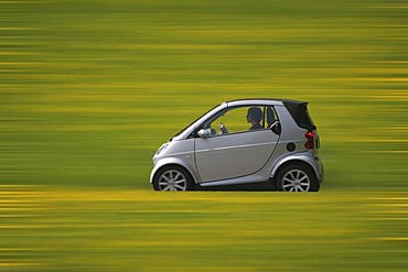 Smart car driving on a country road
