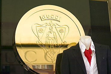 Gucci coat of arms behind a male mannequin in the window display of the Gucci fashion boutique on the Maximilianstrasse, Munich, Bavaria, Germany
