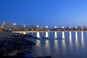 Floodlit beach of Sa Coma shortly before sunrise, Majorca, Balearic Islands, Spain, Europe