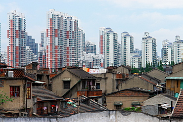 Old buildings against modern skyscrapers in Shanghai, Shanghai Shi, China, Asia