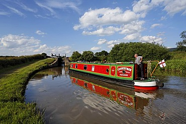 Boat in chanal in front of lock, Cheshire, England
