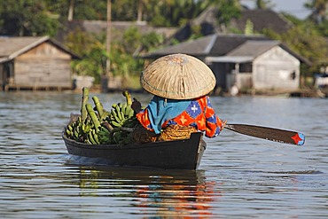 Woman on the way to floating market, Banjarmasin, South-Kalimantan, Borneo, Indonesia