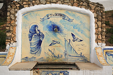 Historic fountain with Azulejos tiles in Carvoeiro, Algarve, Portugal