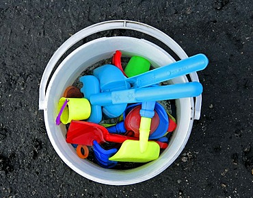Little toy bucket with shovel and baking dishes