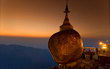 Golden rock and stupa at sunset, Kyaikhtiyo, Myanmar (Burma), Southeast Asia