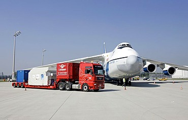 Munich, GER, August 30th 2005 - A heavy load truck in front of a Antonov 124 on Airport Munich. The AN 124 is the second largest air freighter in the world.